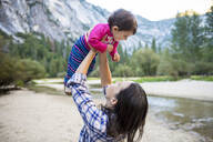 Mother holding her baby girl, Yosemite National Park, California, USA - GEMF03206
