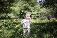 Portrait of cute baby boy in the park - EYAF00559