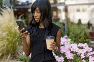 Businesswoman using smartphone in the city - MAUF02917