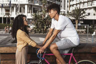 Cool couple with bicycle in the city - RCPF00015