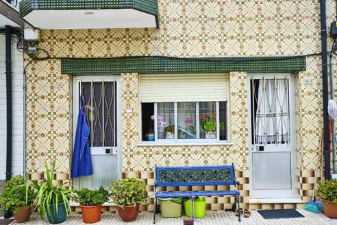 Portugal, Porto, Afurada, Unique ornate house seen on peaceful day - MRF02243