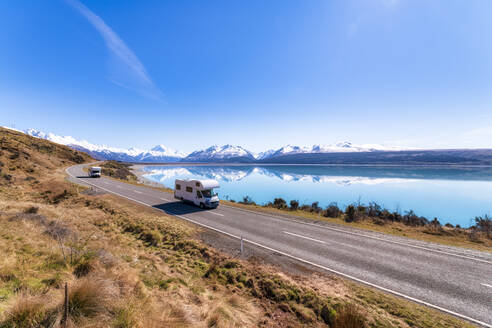New Zealand, South Island, Motor home driving along highway surrounding Lake Pukaki - SMAF01587