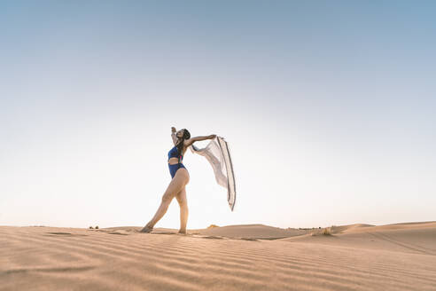 Beautiful young woman in swimsuit in the desert, Merzouga, Morocco - DAMF00128