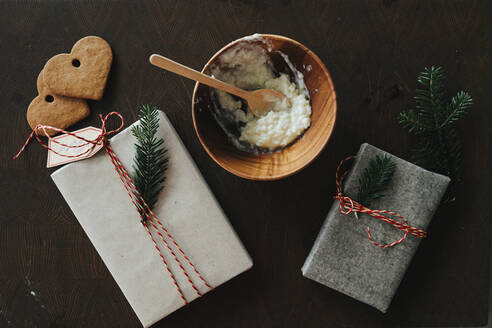Christmas gifts and bowl with porridge - JOHF02257