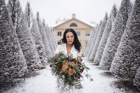 Bride in winter garden - JOHF02308
