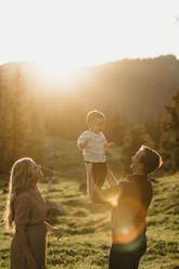 Happy family with little son on a hiking trip at sunset, Schwaegalp, Nesslau, Switzerland - LHPF01119