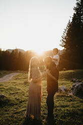 Happy family with little son on a hiking trip at sunset, Schwaegalp, Nesslau, Switzerland - LHPF01125