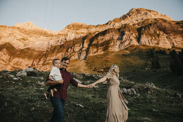 Happy family with little son on a hiking trip at sunset, Schwaegalp, Nesslau, Switzerland - LHPF01131