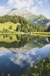 Austria, Carinthia, Scenic view of shiny lake in Carnic Alps - AIF00691