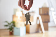 Close-up of woman holding house key in new home - MAMF00860