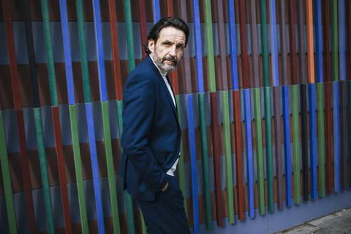 Portrait of mature businessman wearing blue suit - JLOF00331