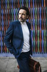 Portrait of mature businessman wearing blue suit - JLOF00334