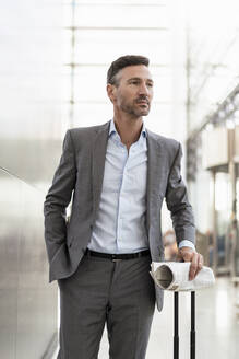 Portrait of confident businessman with baggage - DIGF08439