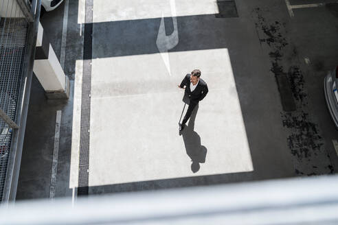 Top view of businessman with baggage on the go - DIGF08508