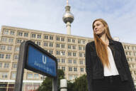 Portrait of redheaded young woman at Alexanderplatz, Berlin, Germany - WPEF01996