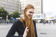 Portrait of redheaded young woman at Alexanderplatz, Berlin, Germany - WPEF02002