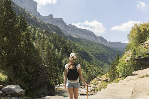 Rear view of woman enjoying the view in the mountains, Ordesa national park, Aragon, Spain - AHSF00852