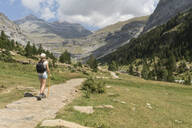 Rear view of woman walking on a trail in mountains, Ordesa national park, Aragon, Spain - AHSF00855