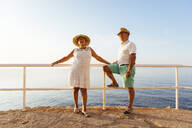Senior couple at viewpoint at the coast, El Roc de Sant Gaieta, Spain - MOSF00004