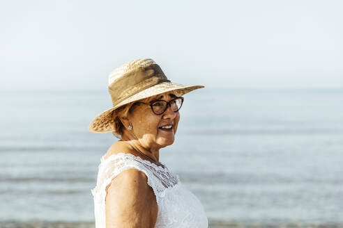 Portrait of content senior woman at the sea, El Roc de Sant Gaieta, Spain - MOSF00034
