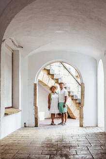 Senior tourist couple in a village, El Roc de Sant Gaieta, Spain - MOSF00043