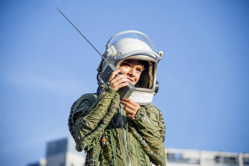 Boy wearing a space suit and using walkie talkie - CJMF00131
