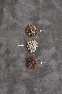 Nuts with arrow symbols - JOHF02913