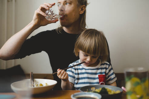 Father and daughter having meal - JOHF02982
