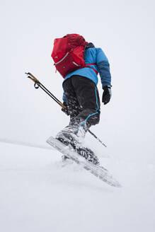 Man ice-skating on frozen lake - JOHF03027