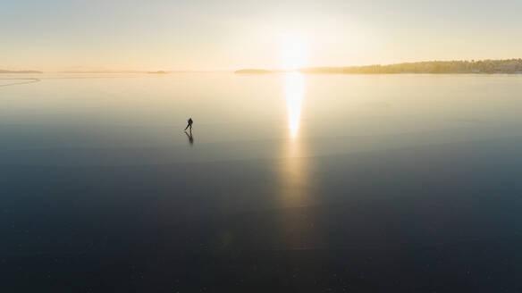 Ice skater on frozen sea - JOHF03033