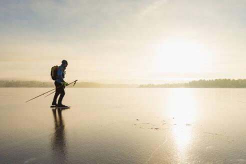 Ice skater on frozen sea - JOHF03036