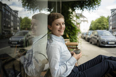Portrait of a relaxed businesswoman at a cafe - KNSF06792