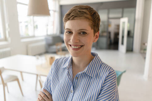 Portrait of smiling businesswoman in office - KNSF06816