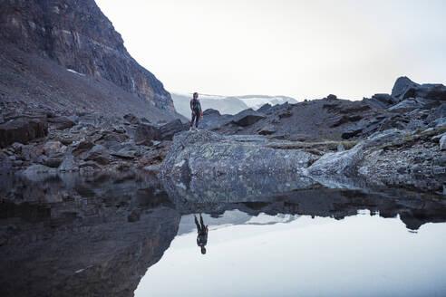 Person at mountain lake - JOHF03632