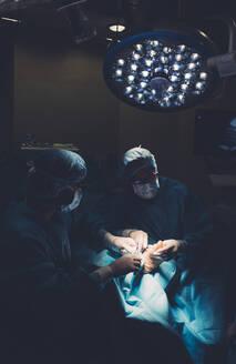 Surgeons during a foot surgery - DAMF00186