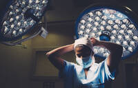 Operating room nurse getting ready for a surgery - DAMF00189