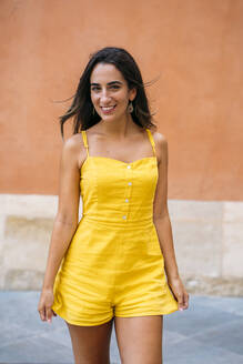 Portrait of beautiful young woman in yellow dress - MPPF00159