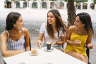 Three happy female friends at a cafe in the city - MPPF00171