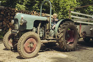 Little boy pretending to drive a tractor - MFF04906