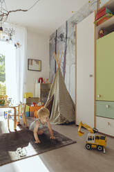 Baby boy playing in his nursery - MFF04927