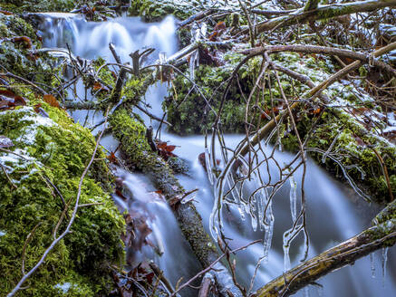 Germany, Bavaria, Ice-covered branches against splashing waterfall - HUSF00089
