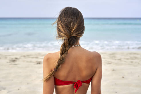 Rear view of a young woman on a beach - EPF00631