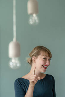 Portrait of excited woman - KNSF06864