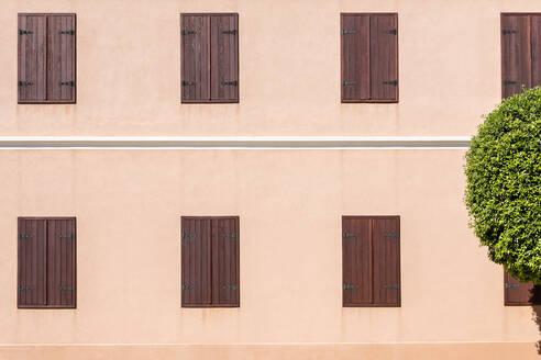 Croatia, Nin, Rows of shut window shutters - NGF00524