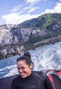 Woman travelling on speedboat, Squamish, Canada - ISF22194