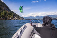 Man kite surfing on inflatable boat, Squamish, Canada - ISF22197