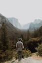 Hiker exploring nature reserve, Yosemite National Park, California, United States - ISF22320