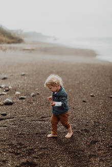 Toddler playing on beach - ISF22326