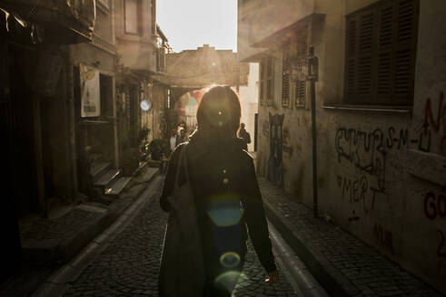 Woman in alleyway in street, Karakoy, Turkey - ISF22452