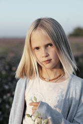 Portrait of a girl standing on a clover field - EYAF00623
